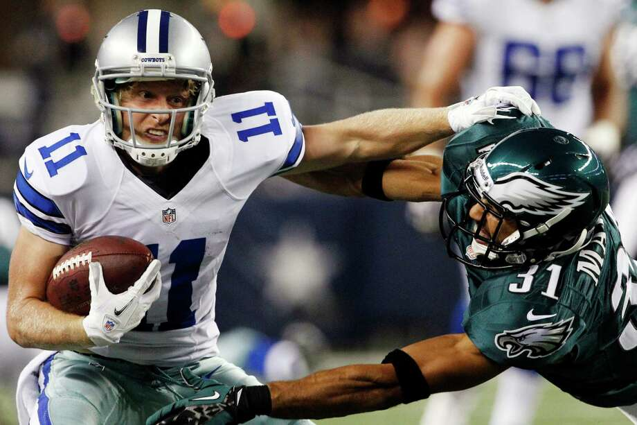 Dallas Cowboys wide receiver Cole Beasley (11) pushes off Philadelphia Eagles defensive back Curtis Marsh (31) during the first half of an NFL football game, Sunday, Dec. 2, 2012, in Arlington, Texas. (AP Photo/Tony Gutierrez) Photo: Tony Gutierrez, Associated Press / AP