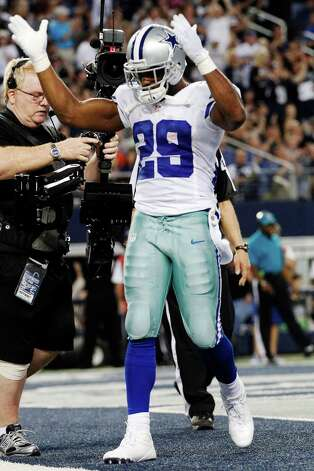 Dallas Cowboys running back DeMarco Murray (29) celebrates his touchdown against the Philadelphia Eagles during the first half of an NFL football game, Sunday, Dec. 2, 2012, in Arlington, Texas. (AP Photo/Tony Gutierrez) Photo: Tony Gutierrez, Associated Press / AP