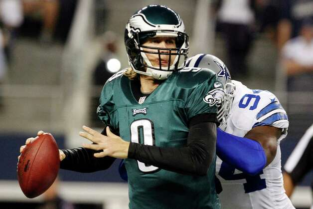 Philadelphia Eagles quarterback Nick Foles (9) is hit by Dallas Cowboys outside linebacker DeMarcus Ware (94) during the first half of an NFL football game, Sunday, Dec. 2, 2012, in Arlington, Texas. (AP Photo/LM Otero) Photo: LM Otero, Associated Press / AP