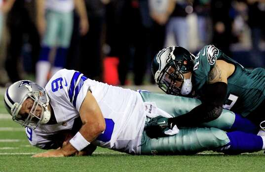 Dallas Cowboys quarterback Tony Romo (9) is tackled by Philadelphia Eagles free safety Kurt Coleman (42) after making a first down during the first half of an NFL football game, Sunday, Dec. 2, 2012, in Arlington, Texas. (AP Photo/LM Otero) Photo: LM Otero, Associated Press / AP