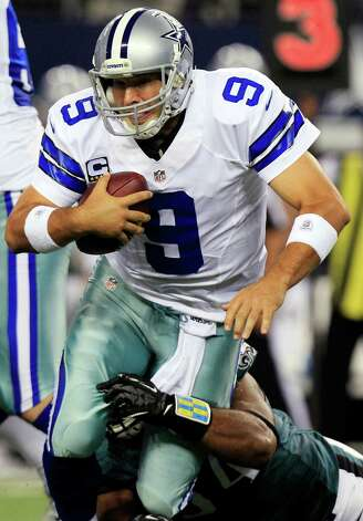 Dallas Cowboys quarterback Tony Romo (9) is sacked by Philadelphia Eagles defensive end Brandon Graham during the first half of an NFL football game, Sunday, Dec. 2, 2012, in Arlington, Texas. (AP Photo/LM Otero) Photo: LM Otero, Associated Press / AP