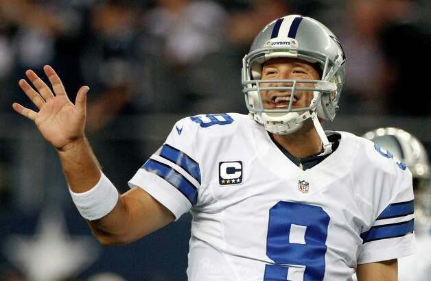 Dallas Cowboys quarterback Tony Romo (9) gestures to teammates before an NFL football game against the Philadelphia Eagles, Sunday, Dec. 2, 2012, in Arlington, Texas. (AP Photo/Tony Gutierrez) Photo: Tony Gutierrez, Associated Press / AP