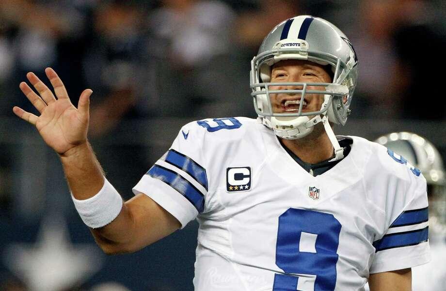 Dallas Cowboys quarterback Tony Romo (9) gestures to teammates before an NFL football game against the Philadelphia Eagles, Sunday, Dec. 2, 2012, in Arlington, Texas. (AP Photo/Tony Gutierrez) Photo: Tony Gutierrez, Associated Press / AP