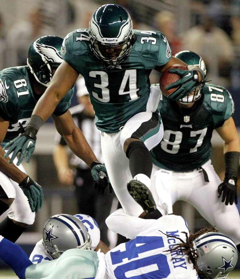 Philadelphia Eagles running back Bryce Brown (34) leaps over Dallas Cowboys strong safety Danny McCray (40) during the first half of an NFL football game, Sunday, Dec. 2, 2012 in Arlington, Texas. (AP Photo/Tony Gutierrez) Photo: Tony Gutierrez, Associated Press / AP