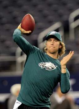 Philadelphia Eagles quarterback Nick Foles warms up before an NFL football game against the Dallas Cowboys Sunday, Dec. 2, 2012 in Arlington, Texas. (AP Photo/LM Otero) Photo: LM Otero, Associated Press / AP