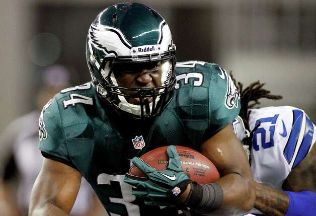 Philadelphia Eagles running back Bryce Brown (34) is pursued by Dallas Cowboys cornerback Mike Jenkins (21) during the first half of an NFL football game, Sunday, Dec. 2, 2012, in Arlington, Texas. (AP Photo/Tony Gutierrez) Photo: Tony Gutierrez, Associated Press / AP