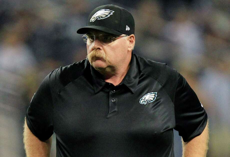 Philadelphia Eagles head coach Andy Reid watches his team on the field before an NFL football game against the Dallas Cowboys, Sunday, Dec. 2, 2012, in Arlington, Texas. (AP Photo/LM Otero) Photo: LM Otero, Associated Press / AP