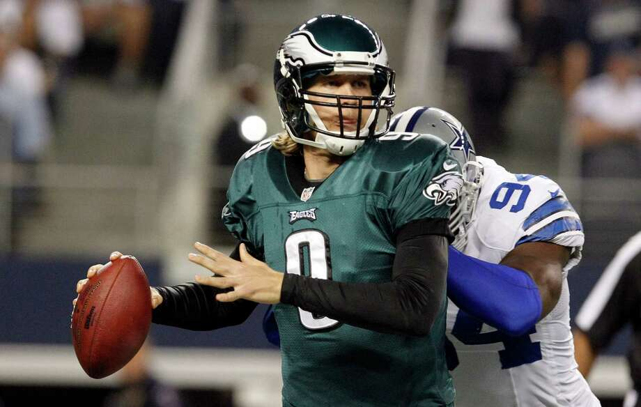 Philadelphia Eagles quarterback Nick Foles (9) is hit by Dallas Cowboys outside linebacker DeMarcus Ware (94) during the first half of an NFL football game Sunday, Dec. 2, 2012 in Arlington, Texas. (AP Photo/LM Otero) Photo: LM Otero, Associated Press / AP