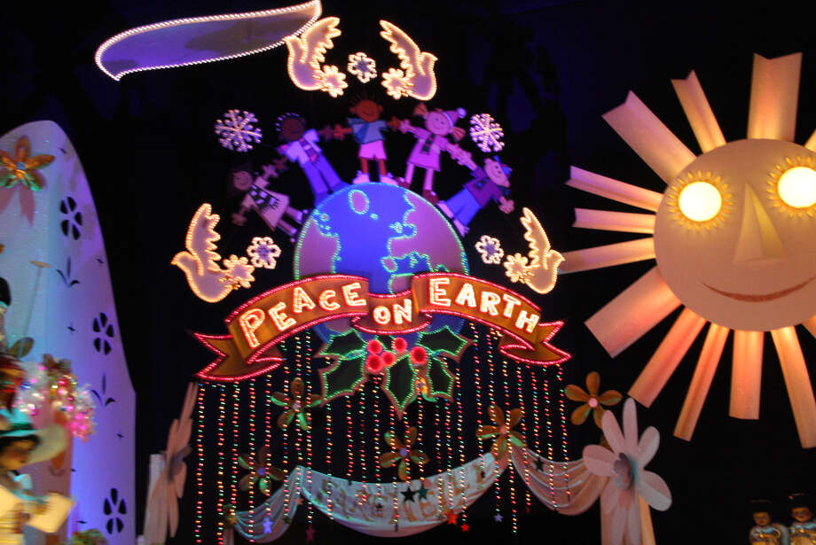 "It's a Small World gets completely transformed for the holidays with the cheery dolls wearing Santa hats and singing  a merry mix of ""Jingle Bells"" and ""Deck The Halls"" in counterpoint with the classic ""It's a Small World."" (Anthony Falzone)"