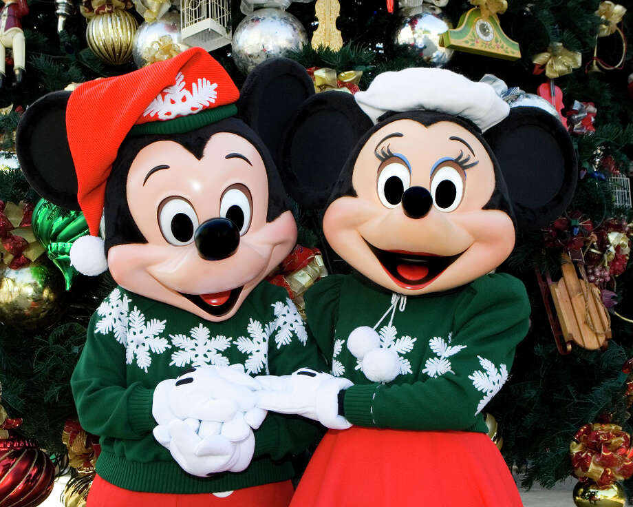 Mickey and Minnie sport holiday sweaters and Santa hats at the Jingle Jangle Jamboree. Photo: Paul Hiffmeyer / ©2010 Disney Enterprises, Inc. All Rights Reserved. For editorial news use only.