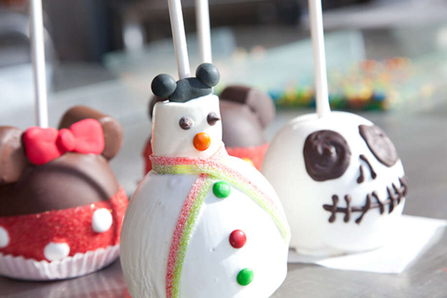 6) Treat yourself to a candy-coated Mickey Mouse or Minnie Mouse. In sweets shops around the park, you'll also find gingerbread Mickies, snowman marshmallows, peppermint pretzel rods and other tempting goodies. (Disney)