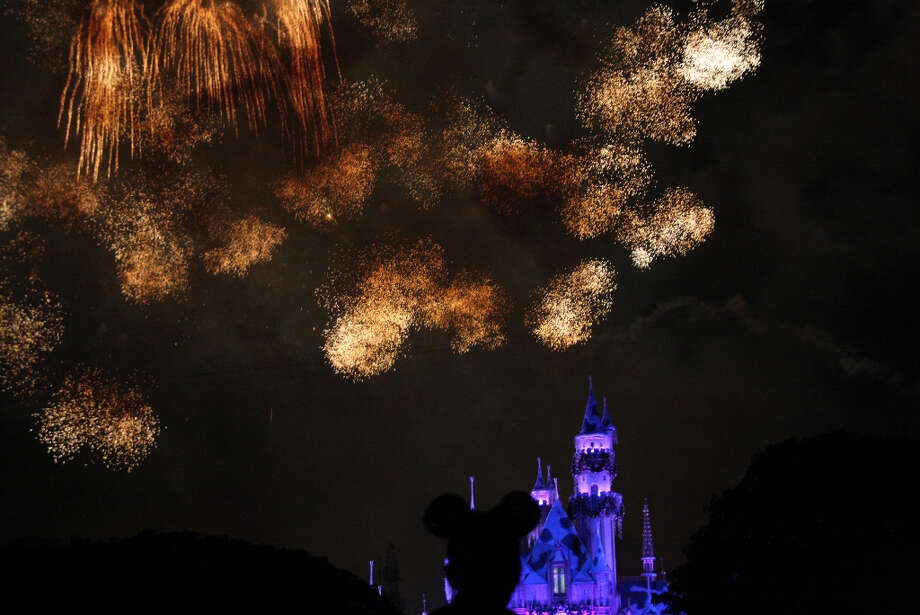 7) See dazzling pyrotechnics burst high above Sleeping Beauty Castle in the Believe... In Holiday Magic fireworks spectacular, complete with a snow flurry finale. (Anthony Falzone)