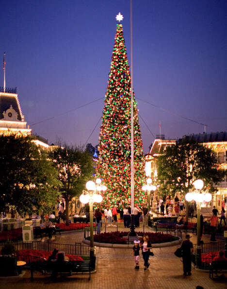 8) Stroll down Disneyland's lavishly decorated Main Street, where you'll find a towering tree, holid