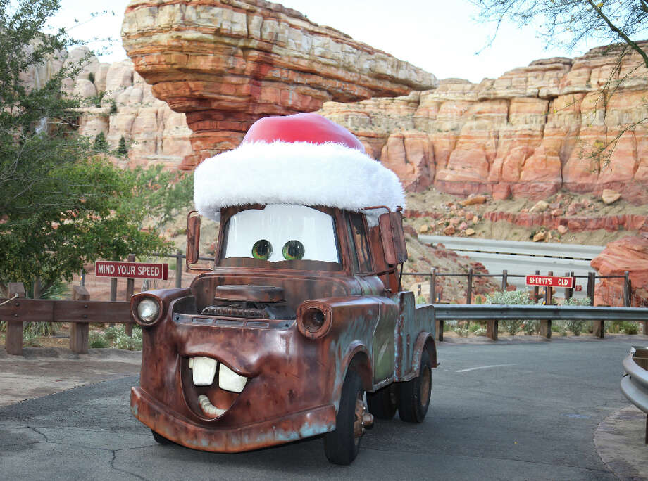 Tow Mater buzzes around Cars Land donning a Santa hat during the holidays. Photo: Paul Hiffmeyer / ©2012 Disneyland Enterprises, Inc. All Rights Reserved. For editorial news use only.