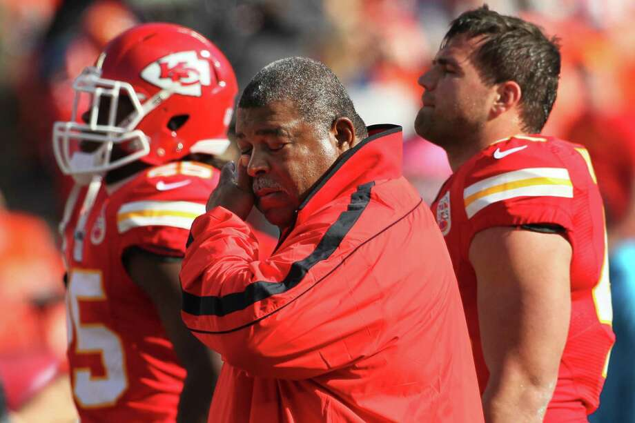Kansas City Chiefs coach Romeo Crennel wipes his eyes before an NFL football game against the Carolina Panthers at Arrowhead Stadium in Kansas City, Mo., Sunday, Dec. 2, 2012. (AP Photo/Colin E. Braley) Photo: Colin E. Braley