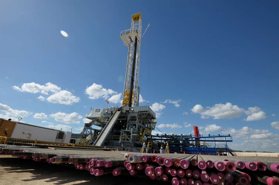 One of BHP Billiton Petroleum s 30 Eagle Ford drilling rigs. Production casing is in the foreground.