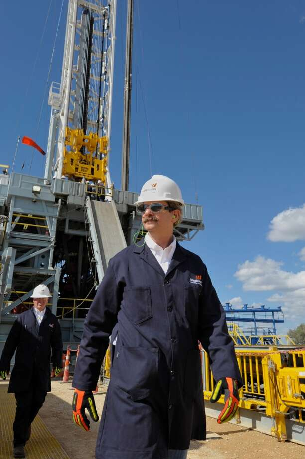 BHP Billiton Petroleum Chief Executive J. Michael Yeager inspecting one of his brand new Eagle Ford Shale drilling rigs built to BHP specifications.