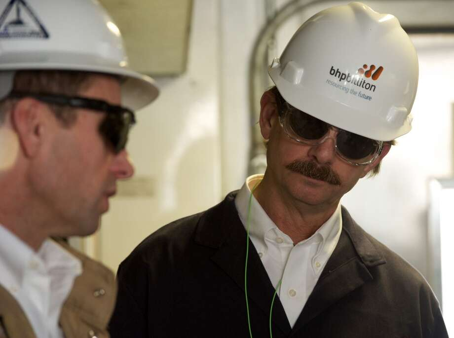 BHP Billiton Petroleum Chief Executive J. Michael Yeager (right) with his global Vice President for Drilling, Derek Cardno, during a visit to one of his Eagle Ford Shale drilling rigs.