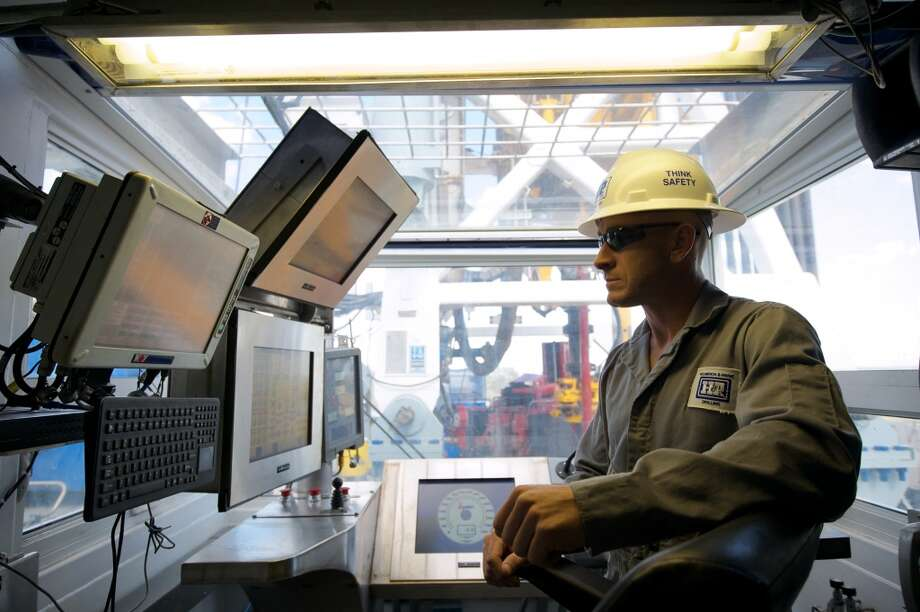 The driller s console in one of BHP Billiton Petroleum s 30 drilling rigs in the Eagle Ford Shale.
