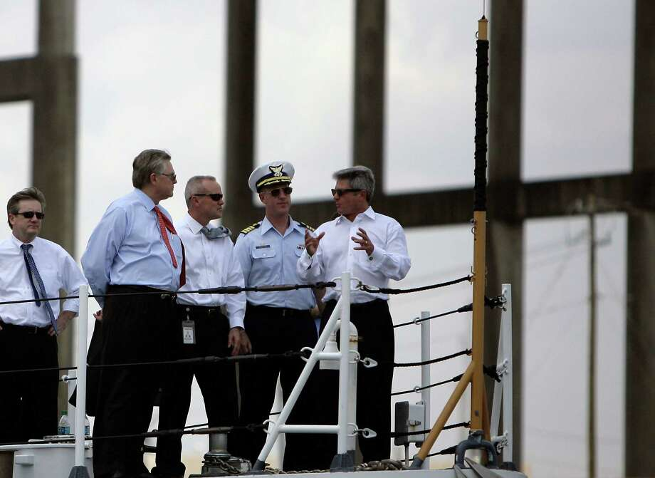 Representative Michael McCaul (R - TX) (right) gestures while talking to port officials on a boat tour through the Houston Ship Channel Wednesday, Aug. 24, 2011, in Houston. Port officials showed McCaul different security measures taken to protect the port in case of an attack. Photo: Cody Duty, Houston Chronicle / © 2011 Houston Chronicle
