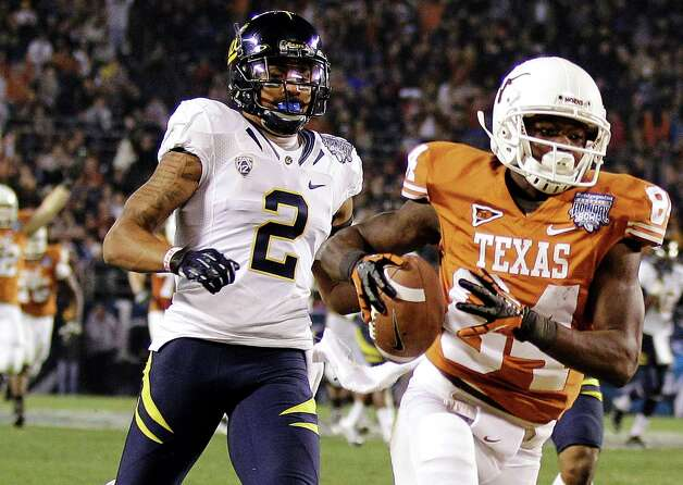 Texas wide receiver Marquise Goodwin (84) outruns California defensive back Marc Anthony (2) to the end zone while scoring on a 47-yard touchdown pass during the third quarter of the Holiday Bowl NCAA college football game, Wednesday, Dec. 28, 2011, in San Diego. (AP Photo/Gregory Bull) Photo: Gregory Bull, Associated Press / AP