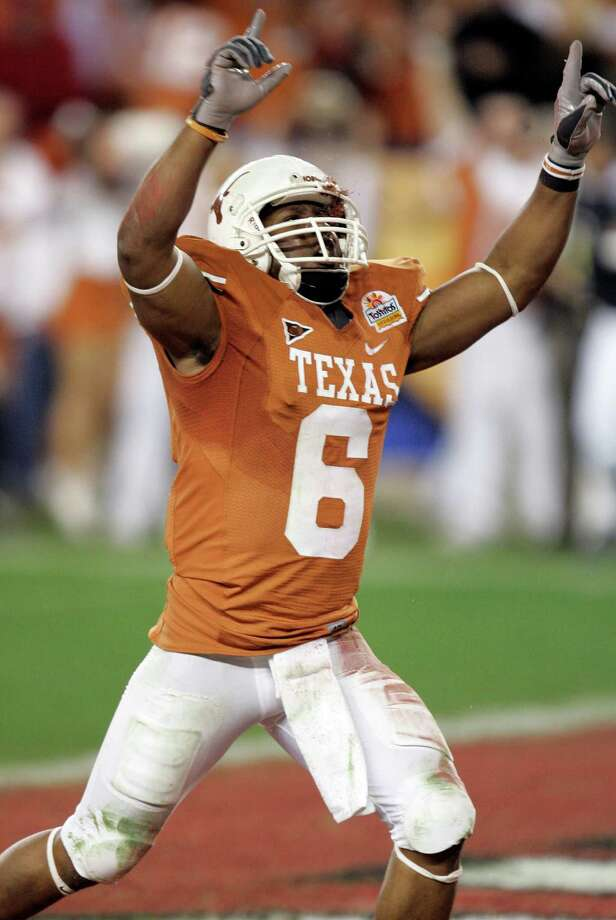 Texas wide receiver Quan Cosby celebrates after scoring the winning touchdown against Ohio State during the Fiesta Bowl NCAA college football game in Glendale, Ariz., Monday, Jan. 5, 2009. Texas won 24-21. Photo: Matt York, AP / AP