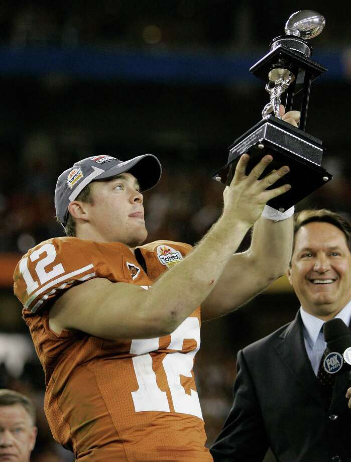 Texas quarterback Colt McCoy holds his offensive player of the game trophy after Texas defeated Ohio State in the Fiesta Bowl NCAA college football game Monday, Jan. 5, 2009, in Glendale, Ariz. Photo: Matt York, AP / AP