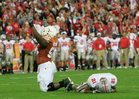 Texas offensive tackle Cedric Dockery, left, celebrates his team's winning touchdown, next to Ohio State defensive back Anderson Russell (cq) in the closing seconds of the Fiesta Bowl NCAA college football game Monday, Jan. 5, 2009, in Glendale, Ariz. (AP Photo/The Arizona Republic, Michael Chow) ** MESA OUT MARICOPA COUNTY OUT MAGS OUT NO SALES ** Photo: Michael Chow, AP / The Arizona Republic