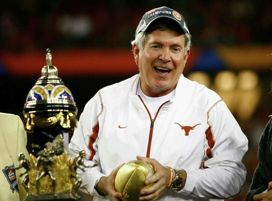 Head coach Mack Brown of the Texas Longhorns celebrates after defeating the Ohio State Buckeyes in the Tostitos Fiesta Bowl Game on January 5, 2009 at University of Phoenix Stadium in Glendale, Arizona. The Longhorns defeated the Buckeyes 24-21 Photo: Jeff Gross, Getty Images / 2009 Getty Images
