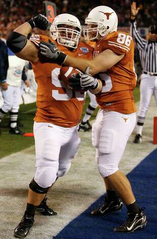 Texas' Derek Lokey, left, celebrates with teammate Mac McWhorter after his 2-yard touchdown reception in the first quarter of the Holiday Bowl football game against Arizona State on Thursday, Dec. 27, 2007, in San Diego. Photo: Denis Poroy, AP / AP