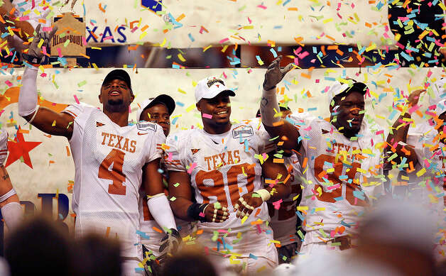 Longhorns' Limas Sweed (from left, Tim Crowder and Brian Orakpo join teammate celebrating as they get showered with confetti as Texas defeated the Iowa Hawkeyes, 26-24, to win the 2006 Alamo Bowl at the Alamodome on Saturday, Dec. 30, 2006. (Edward A. Ornelas/Staff) Photo: EDWARD A. ORNELAS, SAN ANTONIO EXPRESS-NEWS / © San Antonio Express-News