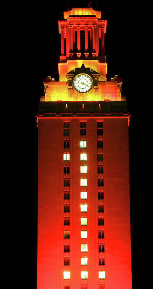 FOR METRO - The University of Texas Tower glows burnt orange with a 1 celebrating the Longhorns win over USC Saturday Jan. 7, 2006 in Austin, Tx. PHOTO BY EDWARD A. ORNELAS/STAFF Photo: EDWARD A. ORNELAS, SAN ANTONIO EXPRESS-NEWS / SAN ANTONIO EXPRESS-NEWS
