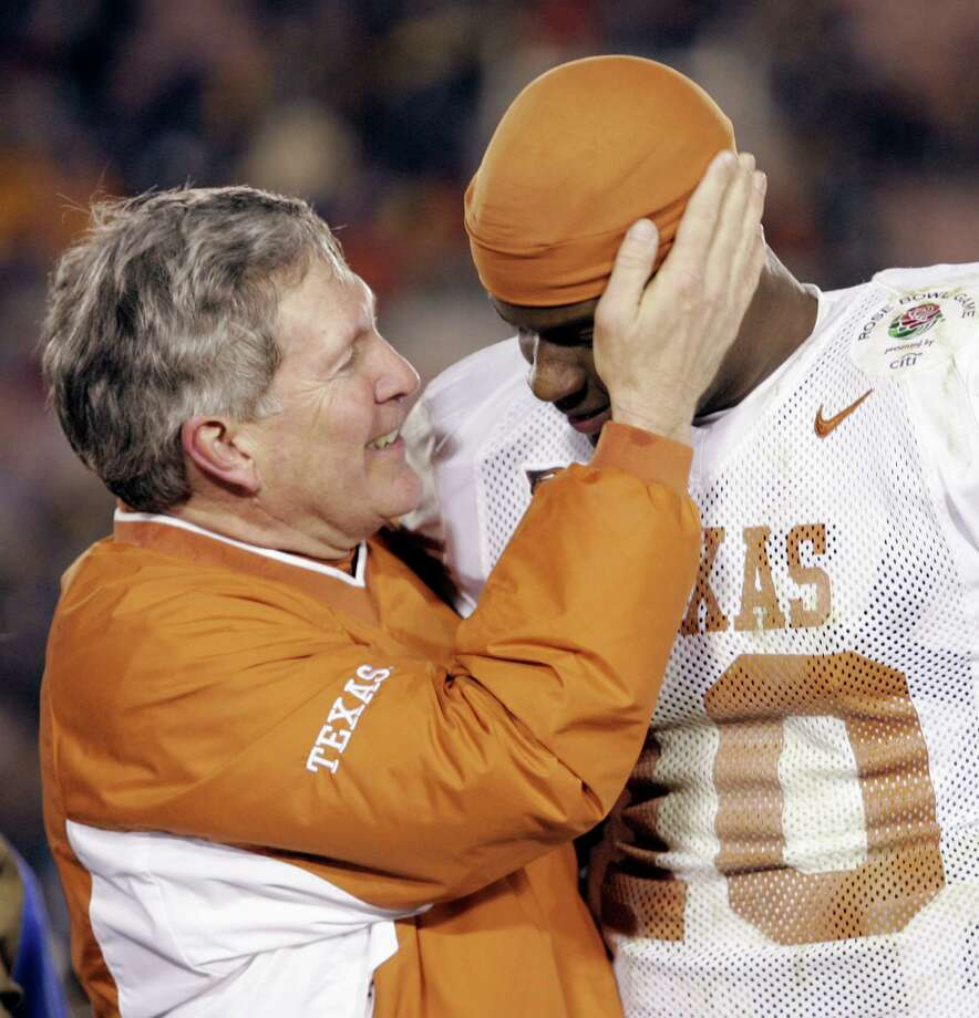 Texas head coach Mack Brown, left, congratulates quarterback Vince Young (10) before he was presented with the MVP trophy at the Rose Bowl in Pasadena, Calif., Saturday, Jan. 1, 2005. Young had four touchdowns in Texas' 38-37 wi over Michigan. Photo: MARK J. TERRILL, AP / AP