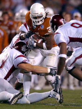 Texas running back Cedric Benson (32) fights for extra yardage against the Washington State defense in the first half of the Holiday Bowl Tuesday, December 30, 2003 at Qualcomm Stadium in San Diego. BAHRAM MARK SOBHANI/STAFF Photo: BAHRAM MARK SOBHANI, SAN ANTONIO EXPRESS-NEWS / SAN ANTONIO EXPRESS-NEWS
