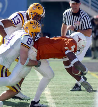 FOR SPORTS - Texas' Roy Williams (4) heads into the endzone for touchdown infront of LSU's Jack Hunt (8) and Corey Webster (13) Jan. 1, 2003 during the SBC Cotton Bowl Classic in Dallas, Texas. Texas went on to defeat LSU by a score of 35 -20. PHOTO BY EDWARD A. ORNELAS/STAFF Photo: EDWARD A. ORNELAS, SAN ANTONIO EXPRESS-NEWS / SAN ANTONIO EXPRESS-NEWS
