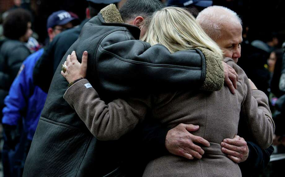 "Mourners embrace after a funeral for Hector ""Macho"" Camacho at St. Cecilia's Roman Catholic Church in New York, Saturday, Dec. 1, 2012. Doctors pronounced Camacho dead on Saturday, Nov. 24, after he was removed from life support at his family's direction. He never regained consciousness after at least one gunman crept up to his car in a darkened parking lot in Puerto Rico and opened fire. Photo: Craig Ruttle, AP / FR61802 AP"