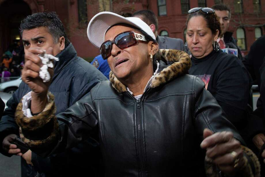 "Maria Matias, mother of former boxing champion Hector ""Macho"" Camacho, reacts to cheers of support from a crowd outside St. Cecilia's Roman Catholic Church in New York where his wake was being held, Friday, Nov. 30, 2012. Doctors pronounced Camacho dead on Saturday, Nov. 24, after he was removed from life support at his family's direction. He never regained consciousness after at least one gunman crept up to his car in a darkened parking lot in Puerto Rico and opened fire. Photo: John Minchillo, AP / FR170537 AP"
