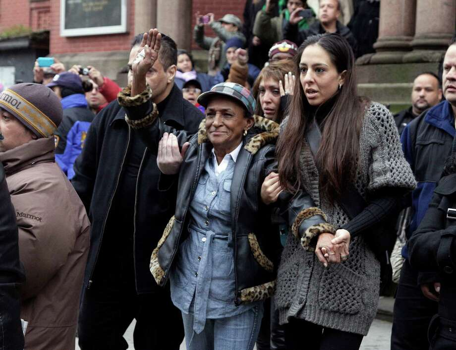"Maria Matias, center, mother of former boxing champion Hector ""Macho"" Camacho is aided as she leaves his funeral at St. Cecilia's Roman Catholic Church in New York, Saturday, Dec. 1, 2012. Doctors pronounced Camacho dead on Saturday, Nov. 24, after he was removed from life support at his family's direction. He never regained consciousness after at least one gunman crept up to his car in a darkened parking lot in Puerto Rico and opened fire. Photo: Richard Drew, AP / AP"