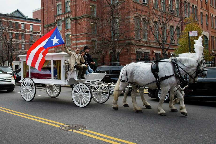 "Former boxing champion Hector ""Macho"" Camacho's funeral carriage approaches St. Cecilia's Roman Catholic Church for his wake on Friday, Nov. 30, 2012, in New York. Doctors pronounced Camacho dead on Saturday, Nov. 24, after he was removed from life support at his family's direction. He never regained consciousness after at least one gunman crept up to his car in a darkened parking lot and opened fire. Photo: John Minchillo, AP / FR170537 AP"