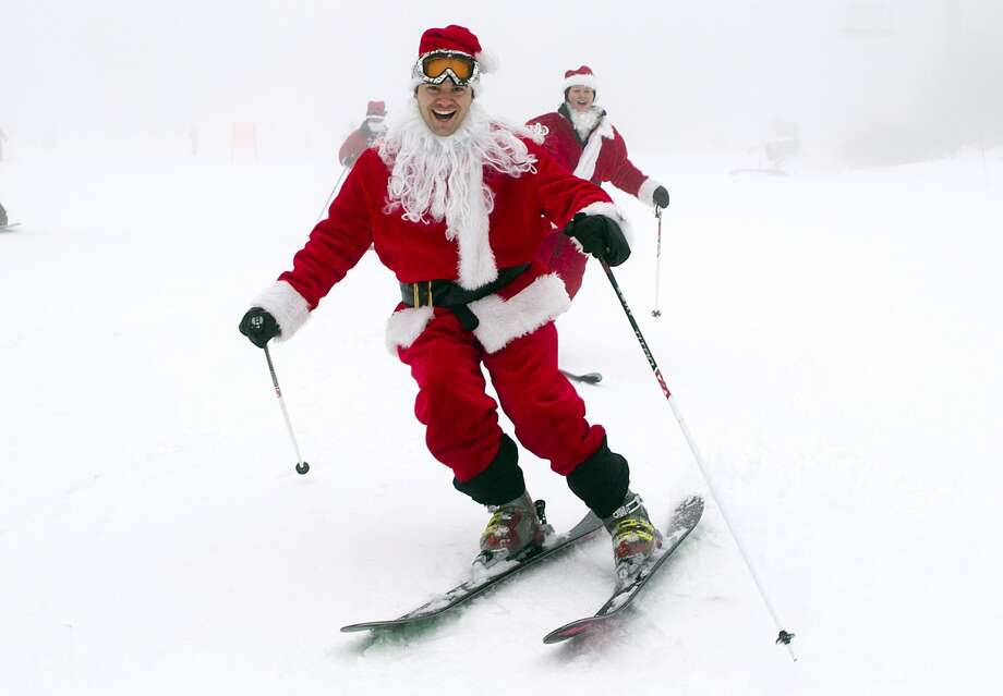 A man dressed as Santa skiis down the slopes at the Sunday River Ski Resort in Newry, Maine, Sunday, Dec. 2, 2012. More than 250 Santas participated in the annual event to raise money to benefit the Bethel Rotary Club's Christmas for Children program. Photo: Robert F. Bukaty, AP / AP