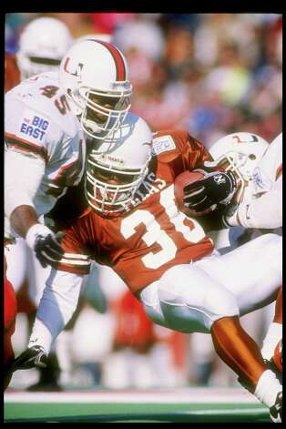 1 Jan 1991: Running back Adrian Walker of the Texas Longhorns is tackled during the Cotton Bowl against the Miami Hurricanes at the Cotton Bowl in Dallas, Texas. Miami won the game 46-3. Mandatory Credit: Joe Patronite /Allsport Photo: Joe Patronite, Getty Images / Getty Images North America