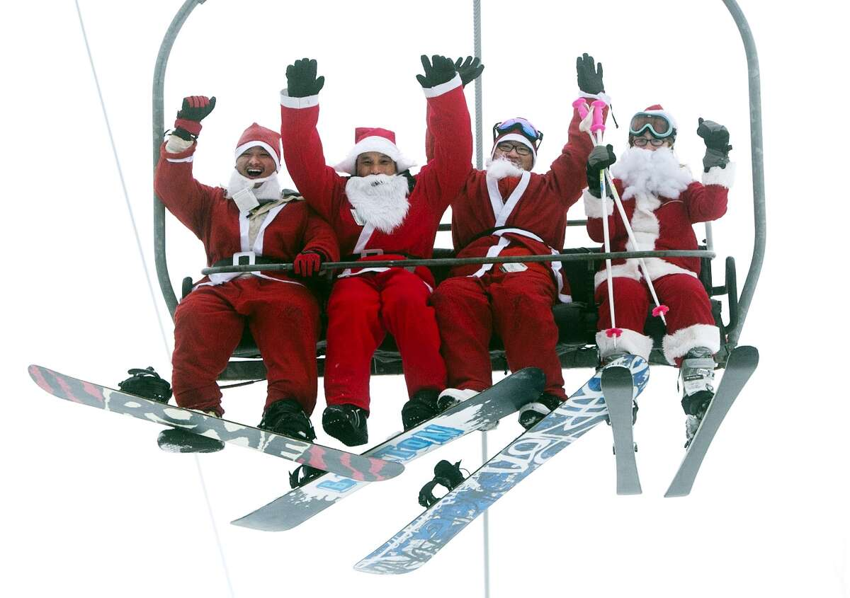 A group of Santas ride a chairlift, Sunday, Dec. 2, 2012, at the Sunday River Ski Resort in Newry, Maine. More than 250 skiers and snowboarders participated in the annual Santa Sunday event to raise money to benefit the Bethel Rotary Club's Christmas for Children program.