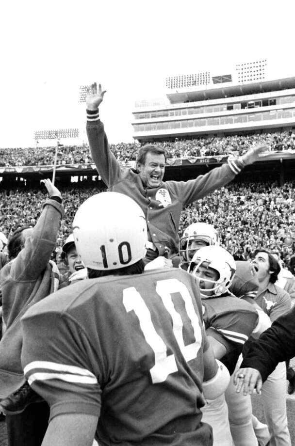 FILE - This Jan. 1, 1973 file photo shows Texas coach Darrell Royal being carried off the field by his players after the Longhorns defeated the University of Alabama, 17-13, in the Cotton bowl in Dallas, Tex. The University of Texas says former football coach Darrell Royal, who won two national championships and a share of a third, has died. He was 88. UT spokesman Nick Voinis on Wednesday, Nov. 7, 2012 confirmed Royal's death in Austin.(AP Photo/File) Photo: Anonymous, Associated Press / AP