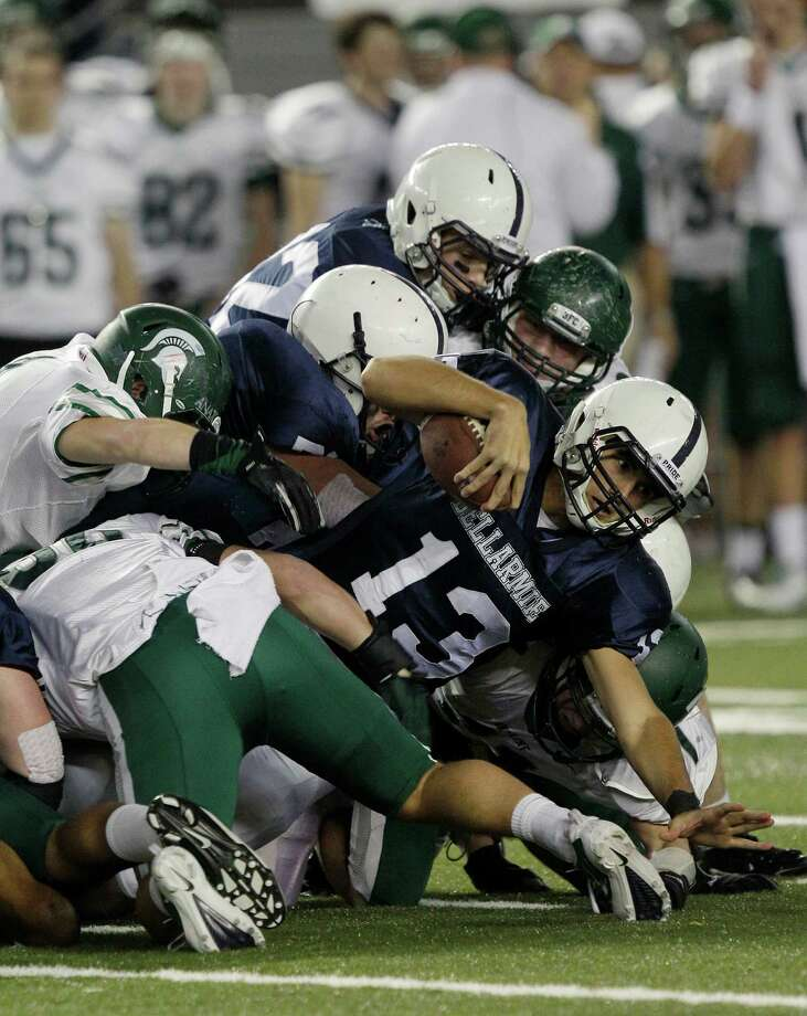 Bellermine quarterback Sefo Liufau (13) is brought down as he keeps the ball against Skyline in the first half of the 4A division high school state championship football game, Saturday, Dec. 1, 2012, in Tacoma, Wash. Photo: Ted S. Warren / Associated Press