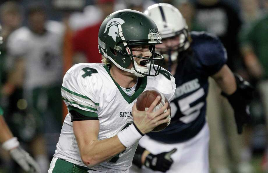 Skyline quarterback Max Browne looks to pass against Bellermine in the first half of the 4A division high school state championship football game, Saturday, Dec. 1, 2012, in Tacoma, Wash. Photo: Ted S. Warren / Associated Press