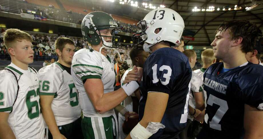 Skyline quarterback Max Browne, center left, is greeted by Bellermine quarterback Sefo Liufau, center right, after Skyline beat Bellermine 49-24 to win the 4A division high school state championship football game, Saturday, Dec. 1, 2012, in Tacoma, Wash. Photo: Ted S. Warren / Associated Press
