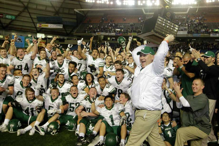Skyline head coach Mat Taylor right, celebrates with the trophy after Skyline beat Bellermine 49-24 to win the 4A division high school state championship football game, Saturday, Dec. 1, 2012, in Tacoma, Wash. Photo: Ted S. Warren / Associated Press