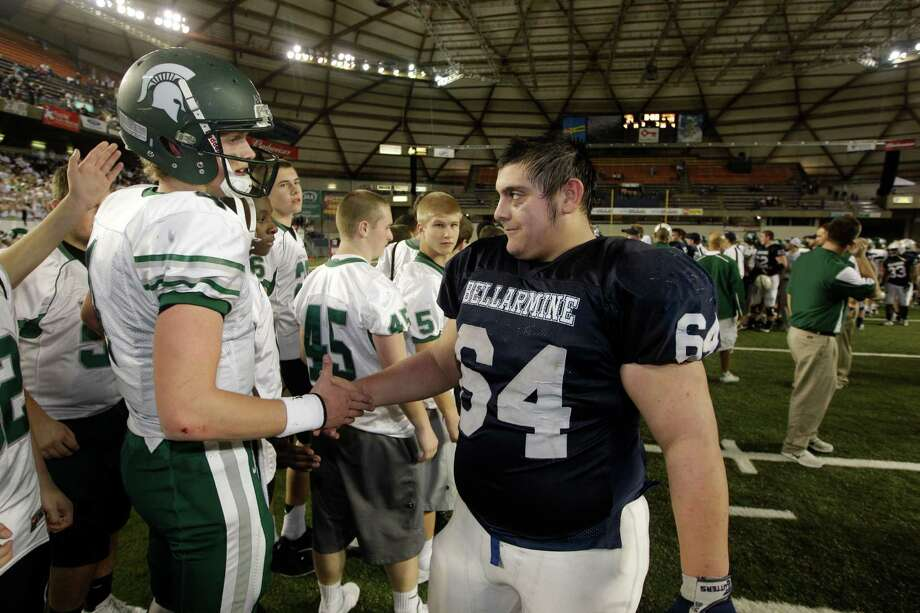 Skyline quarterback Max Browne, left, is greeted by Bellermine's Kevin Kors, right, after Skyline beat Bellermine 49-24 to win the 4A division high school state championship football game, Saturday, Dec. 1, 2012, in Tacoma, Wash. Photo: Ted S. Warren / Associated Press
