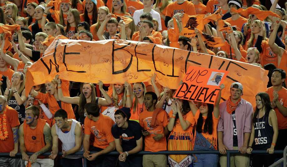 "Eastside Catholic fans cheer as they hold a signs that read ""We Believe"" in the first half of the 3A division high school state championship football game against Bellevue, Friday, Nov. 30, 2012, in Tacoma, Wash. Photo: Ted S. Warren / Associated Press"