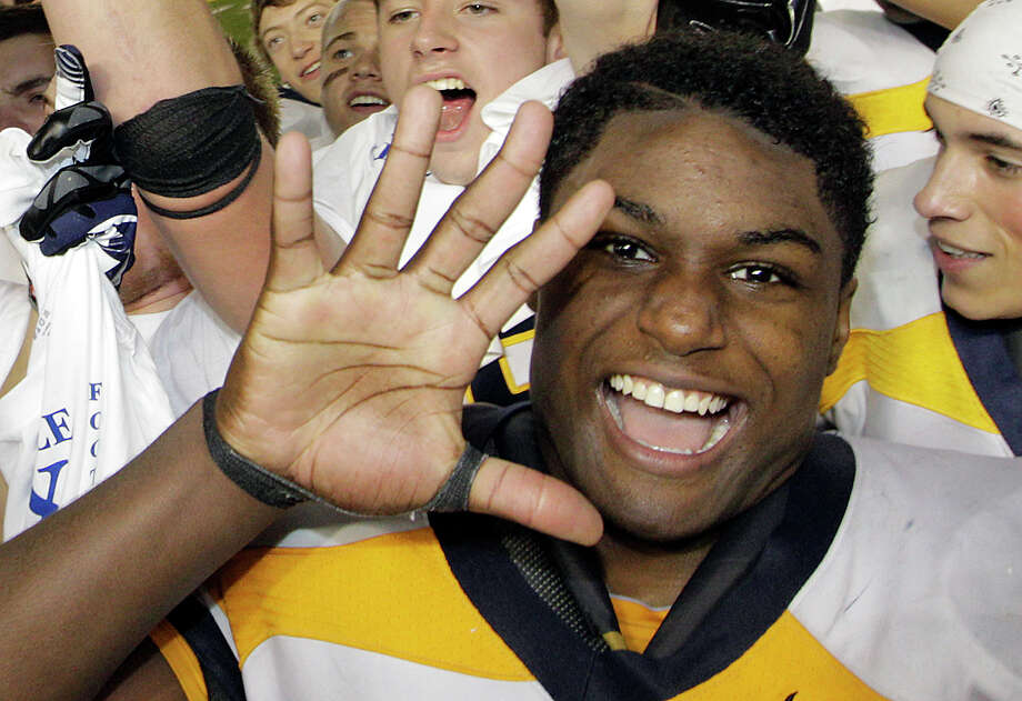 Bellevue's Myles Jack holds up five fingers as he celebrates after Bellevue beat Eastside Catholic, 35-3 to win the 3A division high school state championship football game, for the fifth time in a row, Friday, Nov. 30, 2012, in Tacoma, Wash. Photo: Ted S. Warren / Associated Press